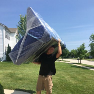 movers at big dog moving company carefully moving furniture into home